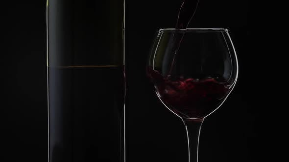 Thumbnail for Rose Wine. Red Wine Pour in Wine Glass Over Black Background. Slow Motion