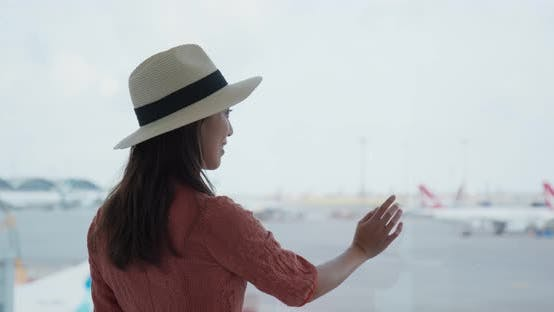 Thumbnail for Woman look at the plane in the airport