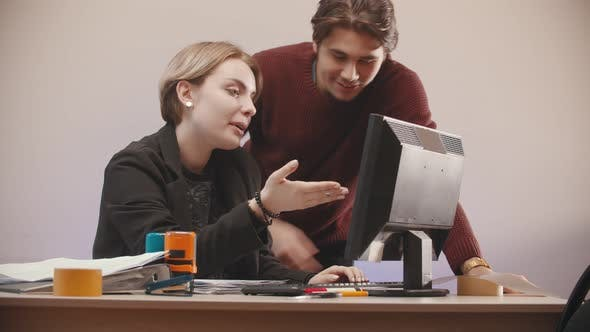 Man  Helping To a Woman Deal with a Computer