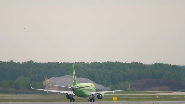 Jet Airliner Picks Up Speed and Takes Off