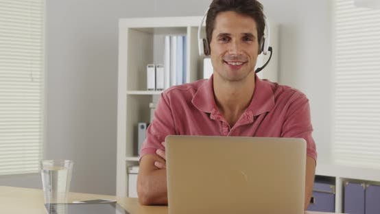 Thumbnail for Attractive company representative sititng at desk