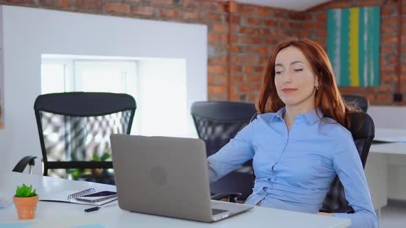Redheaded Overworked Employee