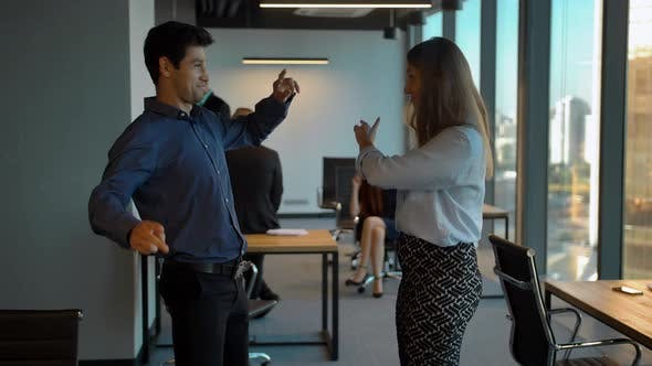 Thumbnail for Successful Businesspeople Celebrating with Dance in Their Office.