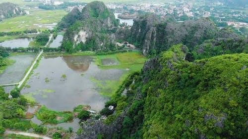 Aerial: North Vietnam karst landscape, drone view of Ninh Binh region, tourist destination