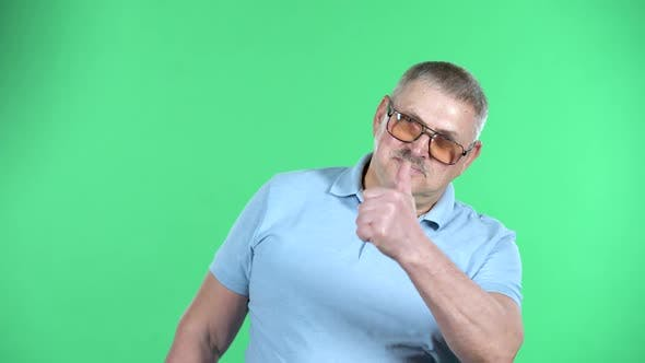 Thumbnail for Portrait of Aged Man Showing Thumbs Up, Gesture Like, Isolated Over Green Background
