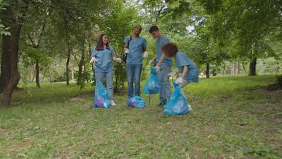 Diverse Multiracial Activists Rejoicing Finishing of Cleaning Outdoors