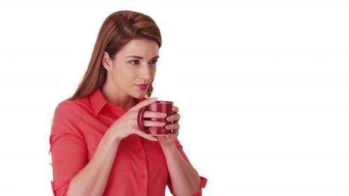 Portrait of gorgeous white female drinking hot beverage on white background