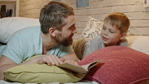 Father and Son Reading Bedtime Story