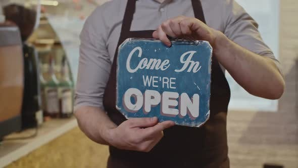 Cover Image for Cafe Barista Showing Open Sign