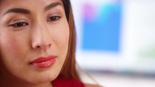 Stressed Japanese businesswoman