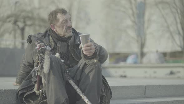 Cover Image for Beggar Homeless Man Tramp. Poverty. Vagrancy. Kyiv. Ukraine.