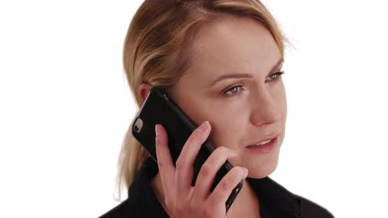Thumbnail for Portrait of attractive Caucasian woman chatting via phone on white background