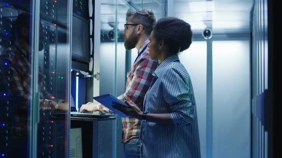 Thumbnail for Diverse IT Colleagues Setting Server Hardware
