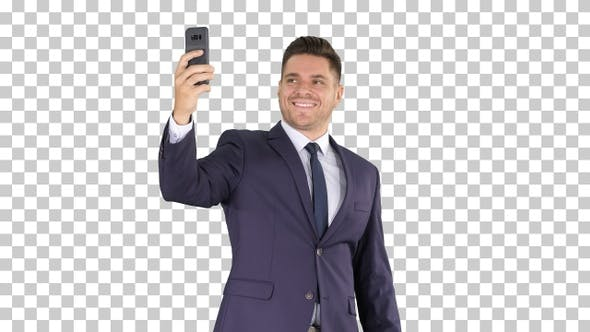 Thumbnail for Happy Young Handsome Businessman Recording Vlog with His Phone
