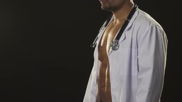 Thumbnail for Sexy Naked African Athletic Muscular Man Wearing Labcoat and Stethoscope