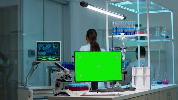 Thumbnail for Chemists Working in Background of Lab Using Pc with Green Screen
