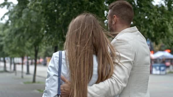 Thumbnail for Couple Embracing and Discussing Something during Walk
