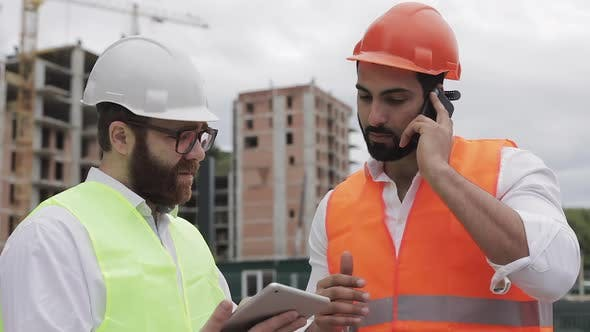 Thumbnail for Engineer Speaks on Mobile Phone on Construction Site and Checks the Work of the Worker. Builder