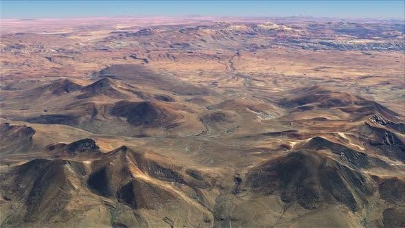 Thumbnail for Flying Over Brown Terrain