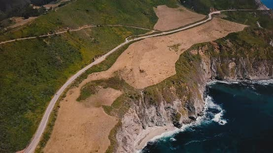 Thumbnail for Drone Panning Left Over Amazing Highway 1 and Beautiful Pacific Ocean Sunny Shore Scenic View in Big
