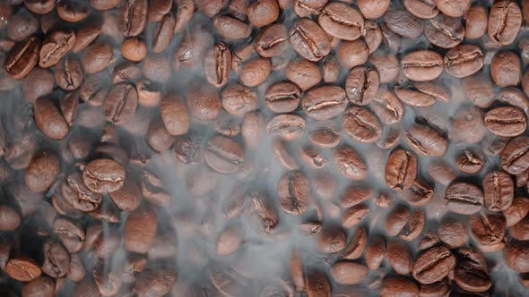 Thumbnail for Close Up of Seeds of Coffee. Fragrant Coffee Beans Are Roasted Smoke Comes From Coffee Beans