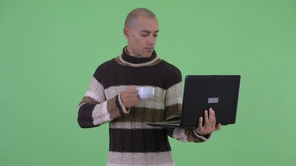 Thumbnail for Happy Bald Multi Ethnic Man Thinking While Using Laptop