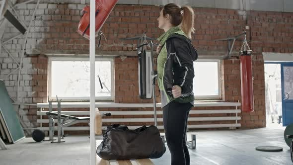 Thumbnail for Female Athlete Going to Train in Gym