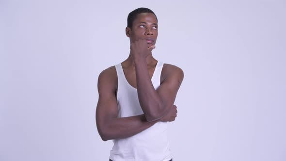 Thumbnail for Young Handsome African Man Thinking and Looking Up