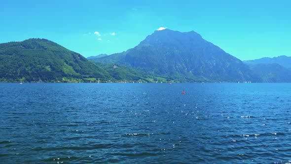 Thumbnail for Lake in Austria with Mountains in the Background - Sunny Summer Day