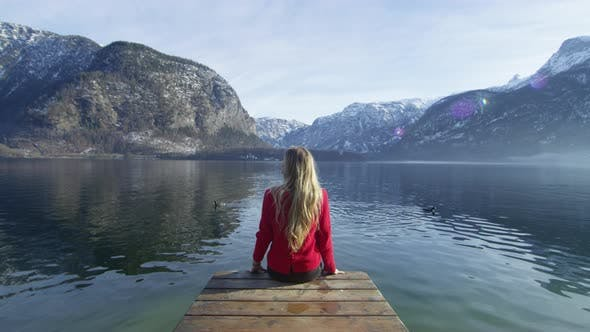 Thumbnail for Woman relaxing on a pontoon at Hallstatt Lake