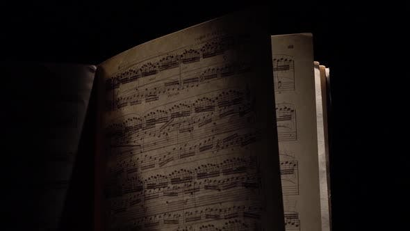 Thumbnail for Vintage Music Notes with Ray of Light on Black, Cam Moves Top Down