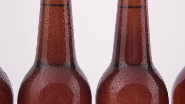 Thumbnail for Conveyor Bottles of Beer with Drops Isolated on White Background