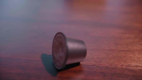 Coffee Pod Falling In Slow Motion