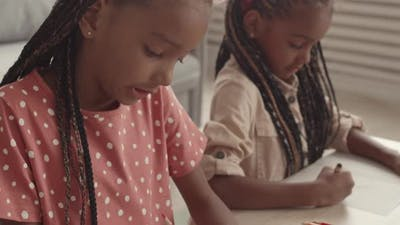 African Girls Learning Drawing