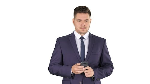 Businessman texting message on the phone on white background