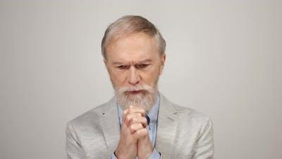 Stressed Man Praying Indoors