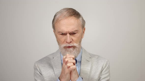 Stressed Man Praying Indoors
