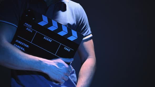 Thumbnail for Video Production Worker with Clapperboard in Hands