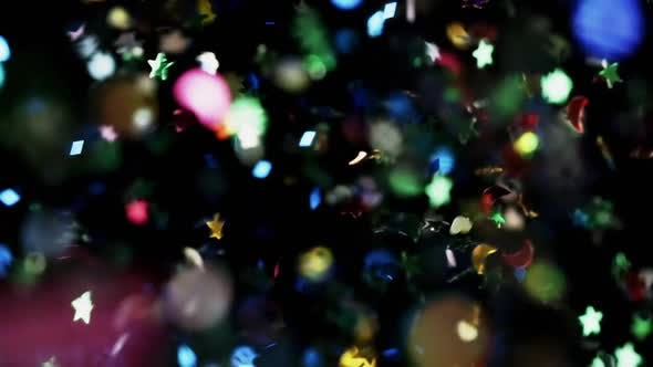 Thumbnail for Multicolored Confetti Flying After Being Exploded Particles Flying and Falling Down Black Background