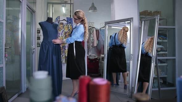 Satisfied Dressmaker Appreciating Sewn Dress