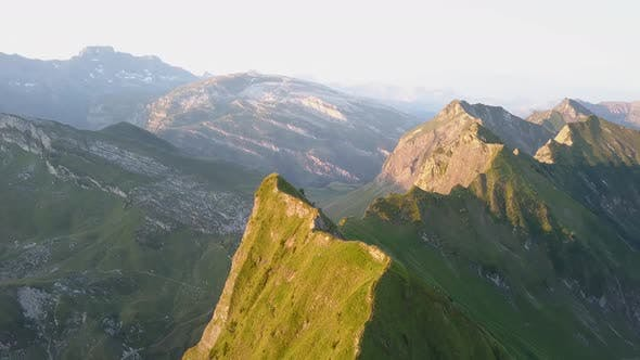 Thumbnail for Aerial Rotation Shot Of A Mountain Peak In Switzerland During Sunrise