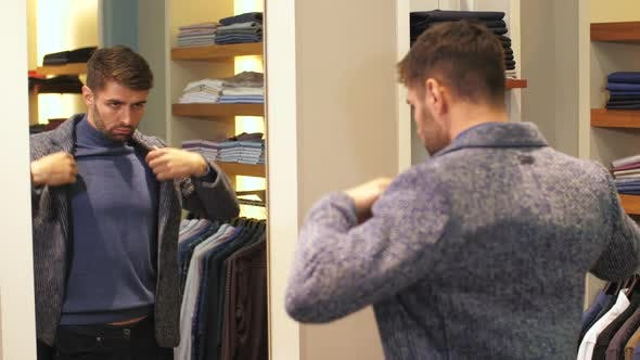 Thumbnail for Young Man Trying on Clothes in Store