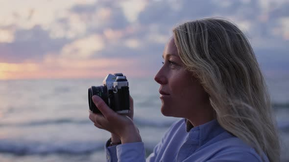 Thumbnail for Photographer On Beach At Sunset