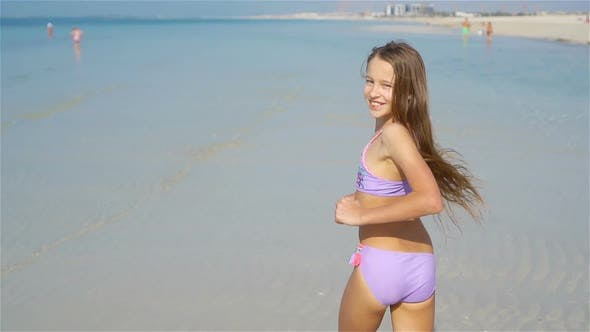 Thumbnail for Cute Little Girl at Beach During Summer Vacation