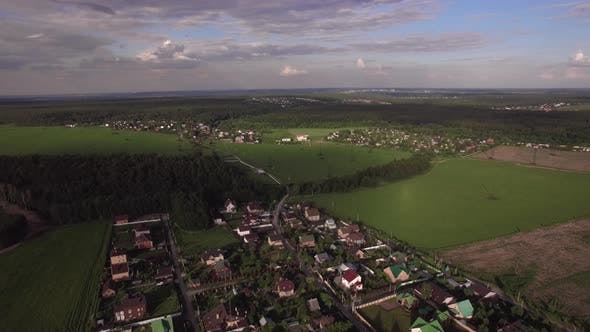 Thumbnail for Flying Over Vast Green Rural Areas and Villages, Russia