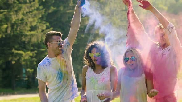 Thumbnail for Couple of Guys Spraying Colorful Powder in the Air and at Their Girlfriends