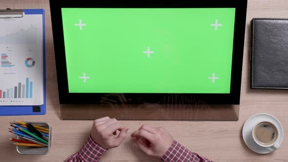 Thumbnail for Top View of Man's Hands Scrolling Over the Left Side of a Green Screen Touch Monitor