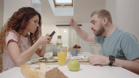 Thumbnail for Jealous Husband Confiscating Smartphone from Wife at Lunch and Interrogating Her