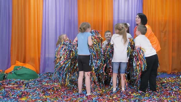 Thumbnail for Colored Ribbons Fly in Different Directions, Children Have Fun. Bright Children's Emotions