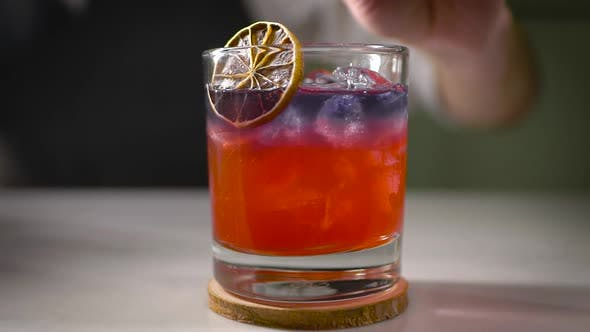 Thumbnail for Cocktail Is Fully Ready. The Bartender Brings a Beautifully Designed Drink To the Customer. Alcohol